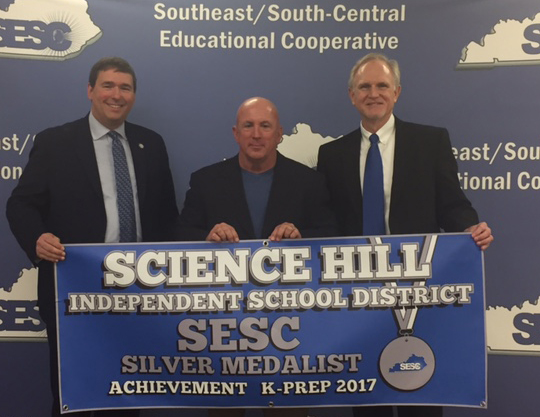 picture of superintendent Dyehouse receiving award from SESC